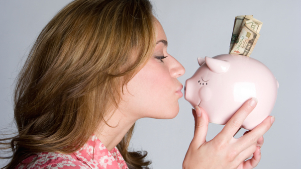 Woman Kissing Piggybank